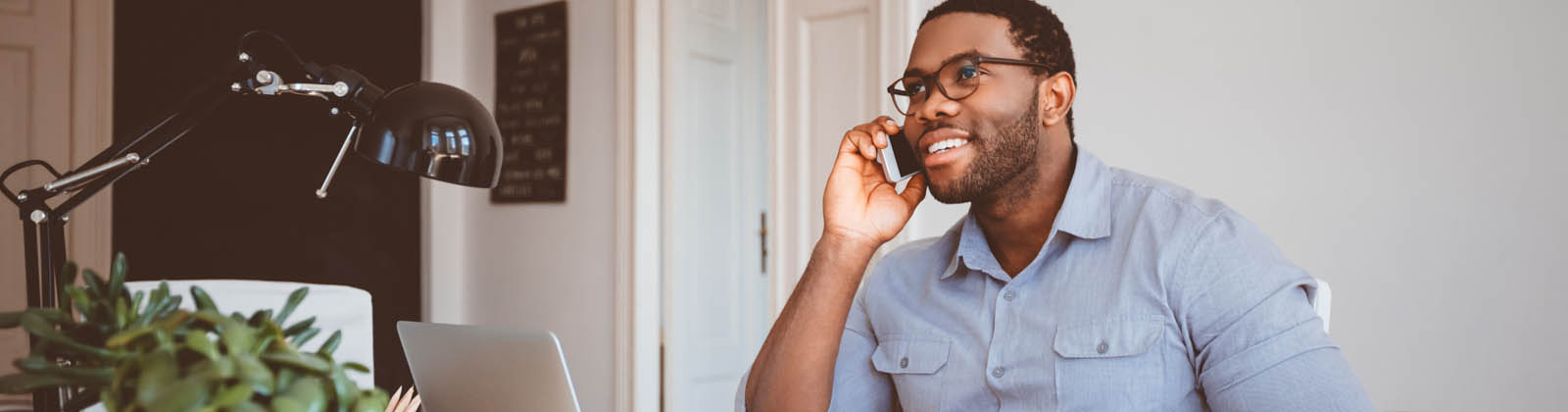 man on phone in office setting