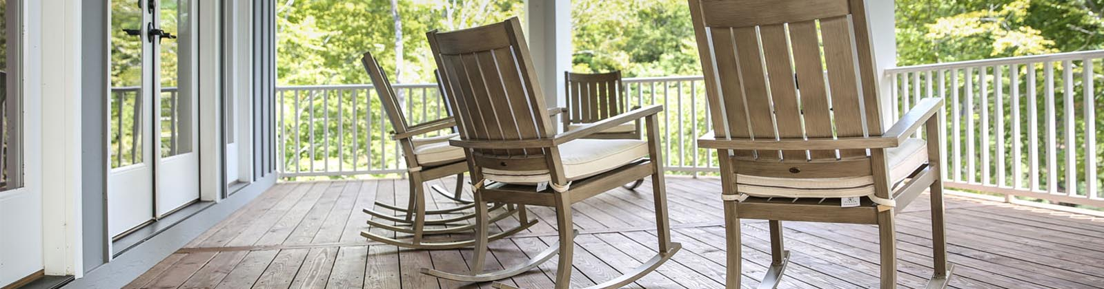 four rocking chairs on a front porch