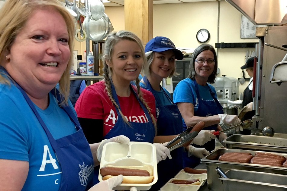 Advantis employees volunteering and helping with food prep.