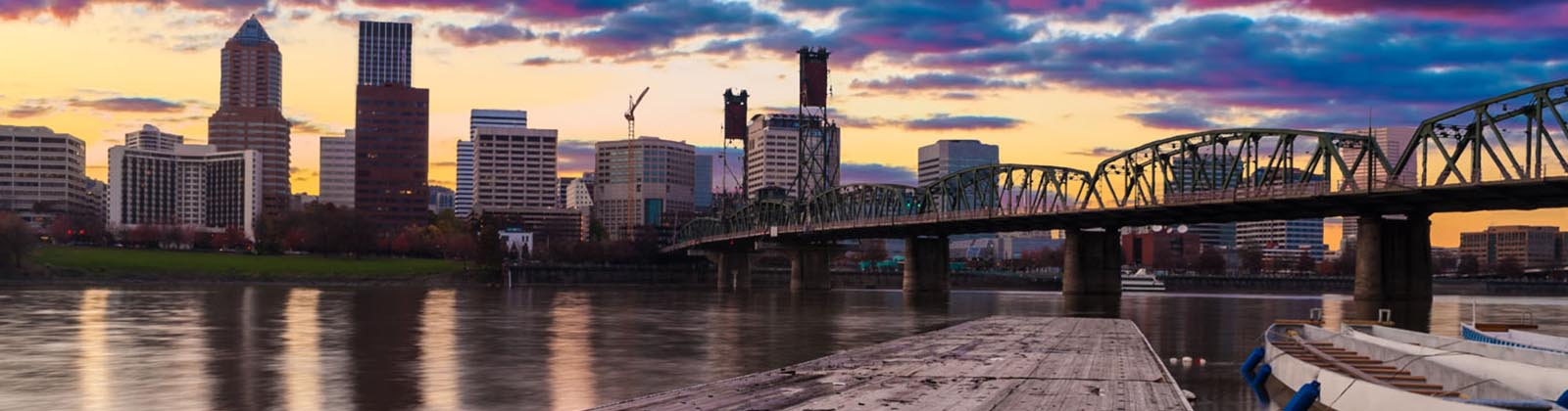 Portland city skyline and Hawthorne Bridge at dusk