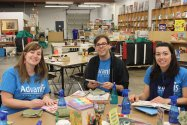 Advantis employee volunteering at the Children's Book Bank, cleaning books.