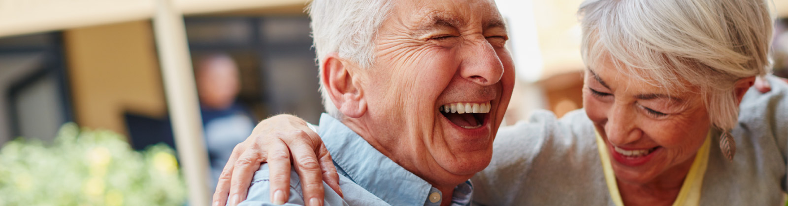 Older couple laughing together in joy.